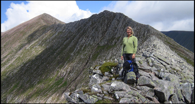A client enjoying a guided walk on the arete that links Carn Mor Dearg and Ben Nevis