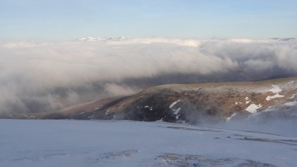 View North over clouds to Cairngorms